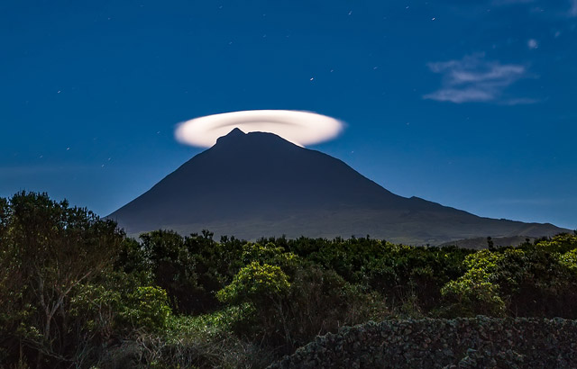 Lenticular cloud on Mount Pico at night